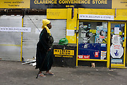 Locals pass-by the Clarence Road Convenience Store. After the riots of London and other UK cities, Sri Lankan-born Sivaharan (Siva) Kandiah's looted shop 'Clarence Convenience Store' in Clarence Road, Hackney.