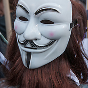 Masked &quot;Anonymous&quot; protester, at the &quot;May Day Rally and Protest in Union Square Park&quot;  protest on May 1, 2015.<br />