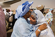 Women greet each other on the tarmac of Al-Fashir airport in north Darfur, Sudan. A delegation hosted by British peer Lord Ahmed, is here to attend the first-ever international Conference on Womens' Challenge in Darfur, hosted by the govenor in his own compound.