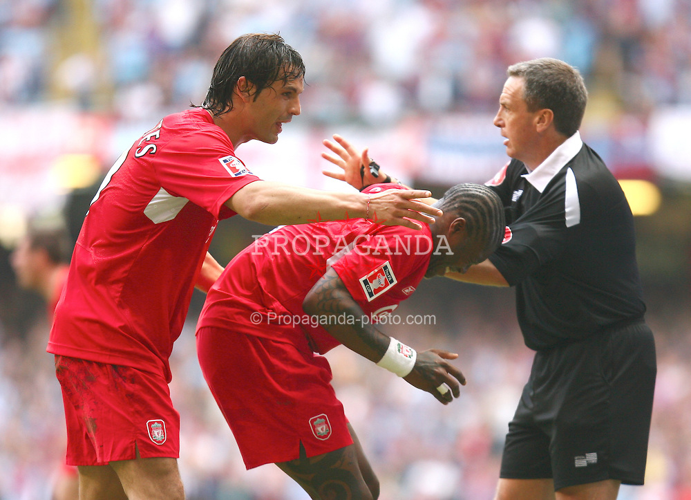 CARDIFF, WALES - SATURDAY, MAY 13th, 2006: Liverpool's Djibril Cisse receives treatment for cramp from Fernando Morientes during the last few minutes of normal time aginst West Ham United during the FA Cup Final at the Millennium Stadium. (Pic by David Rawcliffe/Propaganda)
