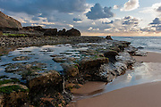 On low tides, the massive stone platforms of Aguda Beach, near Sintra, retain some sea water to form beautiful tidal pools