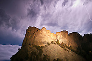 Storm clouds and lightning, over Mount Rushmore National Memorial, at night, South Dakota, USA