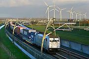 Nederland, Tiel, 11-12-2014Een goederentrein passeert over de betuweroute op weg naar Rotterdam. Windmolens staan in het landschap. Foto: Flip Franssen/Hollandse Hoogte