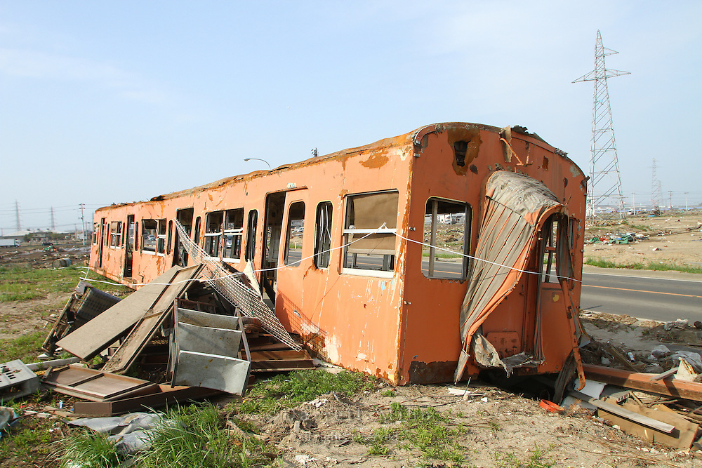 May 16, 2011; Sendai, Miyagi Pref., Japan - A train car sits along the road in Sendai after the magnitude 9.0 Great East Japan Earthquake and Tsunami that devastated the Tohoku region of Japan on March 11, 2011.
