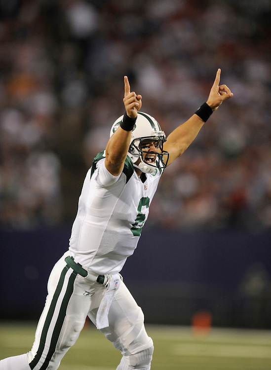 EAST RUTHERFORD, NJ - AUGUST 29: Mark Sanchez #6 of the New York Jets celebrates after a touchdown against the New York Giants in a preseason game at Giants Stadium on August 29, 2009 in East Rutherford, New Jersey. The New York Jets beat the New York Giants 27-25. (Photo by Rob Tringali/ ) *** Local Caption *** Mark Sanchez