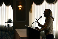Former CIA operative Valerie Plame is silhouetted as she speaks at the Huntingdon Valley Library's spring author brunch and luncheon Sunday, April 10, 2016 at Philmont Country Club in Huntingdon Valley, Pennsylvania.  (Photo by William Thomas Cain)
