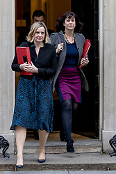 "© Licensed to London News Pictures. 26/02/2019. London, UK. Secretary of State for Work and Pensions Amber Rudd (L) and Minister of State at Department for Business, Energy and Industrial Strategy Claire Perry (R) leave 10 Downing Street after the Cabinet meeting. Both ministers have suggested that they would consider resigning from government in order to vote against the possibility of a ""no deal"" Brexit. Photo credit: Rob Pinney/LNP"