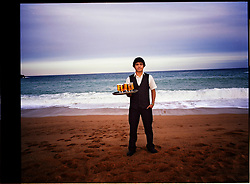 2012.Tossa de Mar, Girona.Jose Cedeño,19 years old is from Ecuador.He works as waiter in a restaurant.©Carmen Secanella