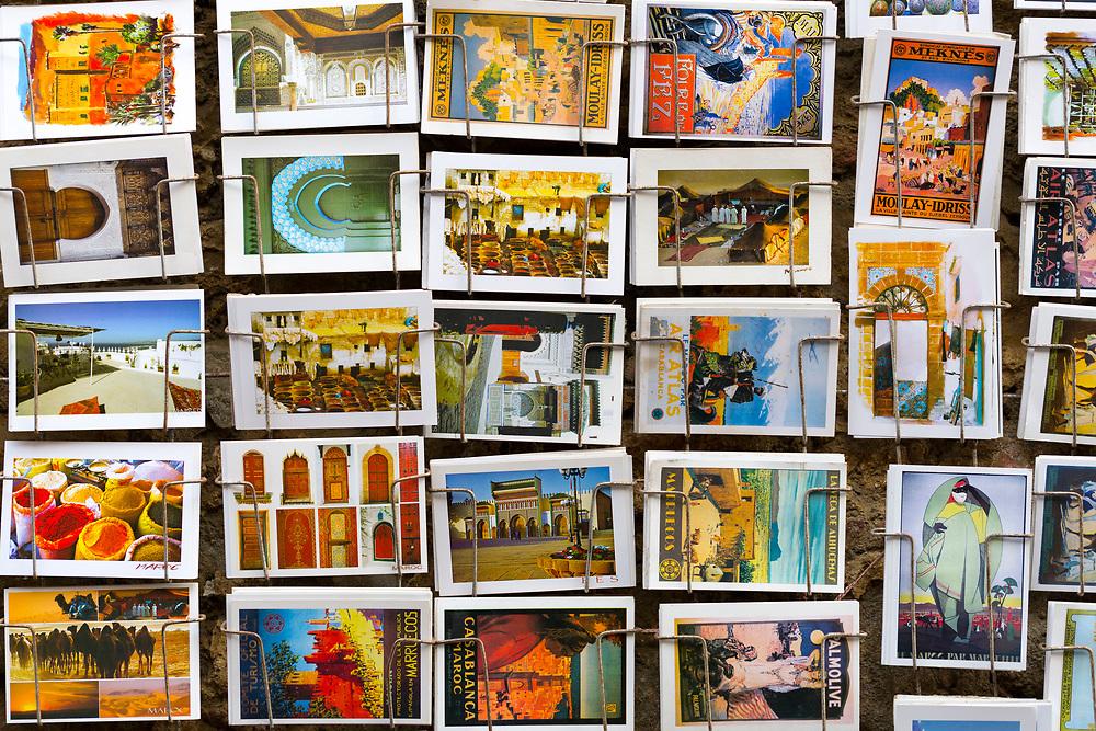 Postcard artwork stand, Asilah, Northern Morocco, 2015-08-10.