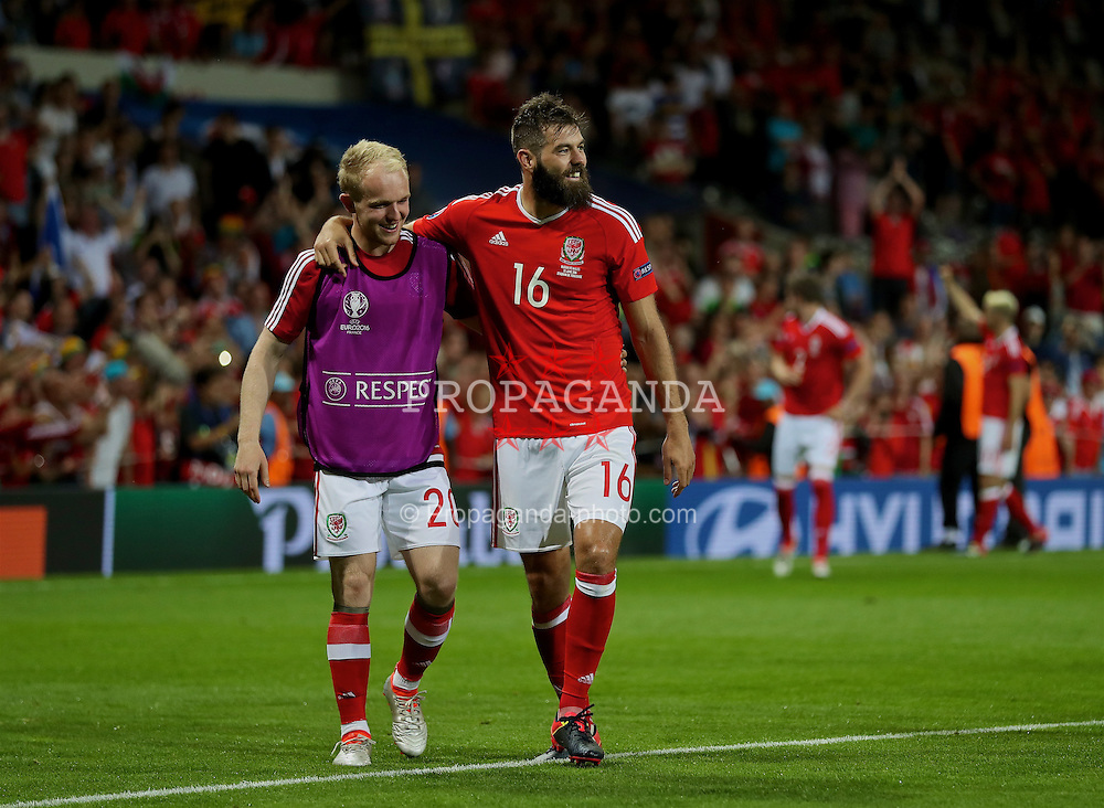TOULOUSE, FRANCE - Monday, June 20, 2016: Wales' Jonathan Williams and Joe Ledley celebrates the 3-0 victory over Russia and reaching the knock-out stage during the final Group B UEFA Euro 2016 Championship match at Stadium de Toulouse. (Pic by David Rawcliffe/Propaganda)