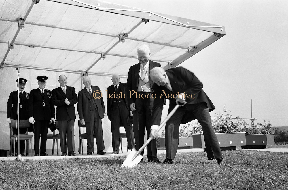 President de Valera cuts the first sod for the Faculty of Science building of University College Dublin, at Belfield. This was the first building of the new university campus. Behind the President is Professor Michael Tierney, President of the college, and among those in the background are Dr Patrick Hillery, Minister for Education, Dr Ryan, Minister for Finance..07.06.1962