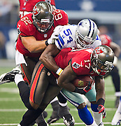 DALLAS, TX - SEPTEMBER 23:  Arrelious Benn #17 of the Tampa Bay Buccaneers is tackled by Bruce Carter #54 of the Dallas Cowboys at Cowboys Stadium on September 23, 2012 in Dallas, Texas.  The Cowboys defeated the Buccaneers 16-10.  (Photo by Wesley Hitt/Getty Images) *** Local Caption *** Arrelious Benn