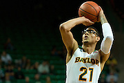 WACO, TX - NOVEMBER 12: Isaiah Austin #21 of the Baylor Bears shoots a free-throw against the South Carolina Gamecocks on November 12, 2013 at the Ferrell Center in Waco, Texas.  (Photo by Cooper Neill/Getty Images) *** Local Caption *** Isaiah Austin