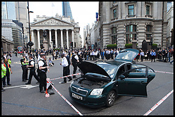 A Suspicious car in the City of London as Police seal of an area in Bank after what is thought to be a Suspicious Package in the Bank district of London, United Kingdom. Thursday, 15th May 2014. Picture by Daniel Leal-Olivas / i-Images