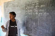 Frida Francis and the team of volunteers prepare for their school training session with pupils as part of the ICS Raleigh SWASH (school water, sanitation and hygiene plan) project. Mbulu, Manyara district, Tanzania. Working in partnership with the Diocese of Mbulu Development Department (DMDD); part of Caritas Tanzania.