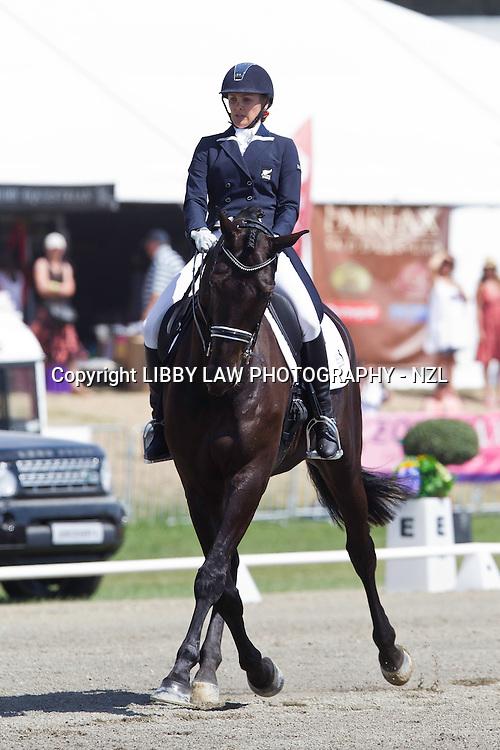 NZL-Britta Pedersen (UPENDO) 2ND: NZ HORSE & PONY MAGAZINE FEI INTERMEDIATE 1: 2013 NZL-Horse Of The Year Show: Friday