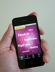 Man using Germanwings app to book flight on an iPhone 4G smart phone