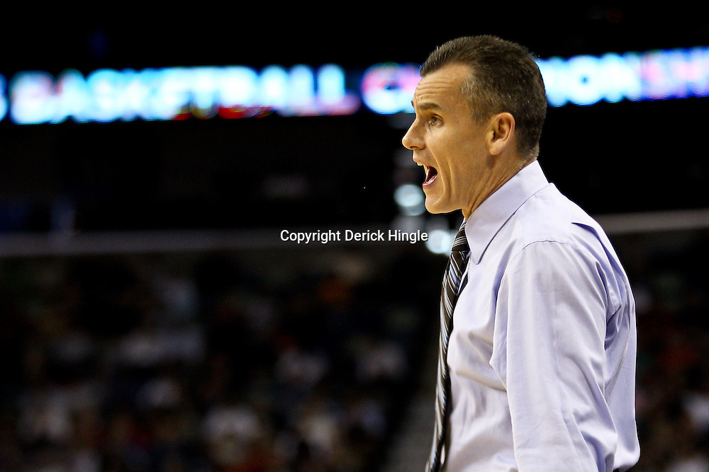 Mar 24, 2011; New Orleans, LA; Florida Gators head coach Billy Donovan against the Brigham Young Cougars during the first half of the semifinals of the southeast regional of the 2011 NCAA men's basketball tournament at New Orleans Arena.  Mandatory Credit: Derick E. Hingle