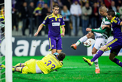 Jasmin Handanovic of Maribor and Aleksander Rajcevic of Maribor vs Islam Slimani of Sporting during football match between NK Maribor and Sporting Lisbon (POR) in Group G of Group Stage of UEFA Champions League 2014/15, on September 17, 2014 in Stadium Ljudski vrt, Maribor, Slovenia. Photo by Vid Ponikvar  / Sportida.com