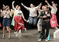 "Rock and Roll star Dustin Condit as ""Conrad Birdie"" performs on the Ed Sullivan Show much to the delight of the ladies (l-r Amanda Noel ""Margie"", Nicole Beland ""Nancy"", Elizabeth Jackman ""Reporter"", Lily Newton ""Gloria Rasputin and Amy Wargo ""Alice"" during ""Bye Bye Birdie"" dress rehearsal Tuesday evening at Interlakes High School.  Bye Bye Birdie will be presented by Interlakes Drama on April 10th-11th and April 17th-18th at 7pm as well as a matinee performance on April 18th at 1pm.  (Karen Bobotas/for the Laconia Daily Sun)"