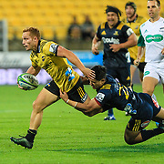 Ihaia West evades a tackler during the super rugby union  game between Hurricanes  and Highlanders, played at Westpac Stadium, Wellington, New Zealand on 24 March 2018.  Hurricanes won 29-12.