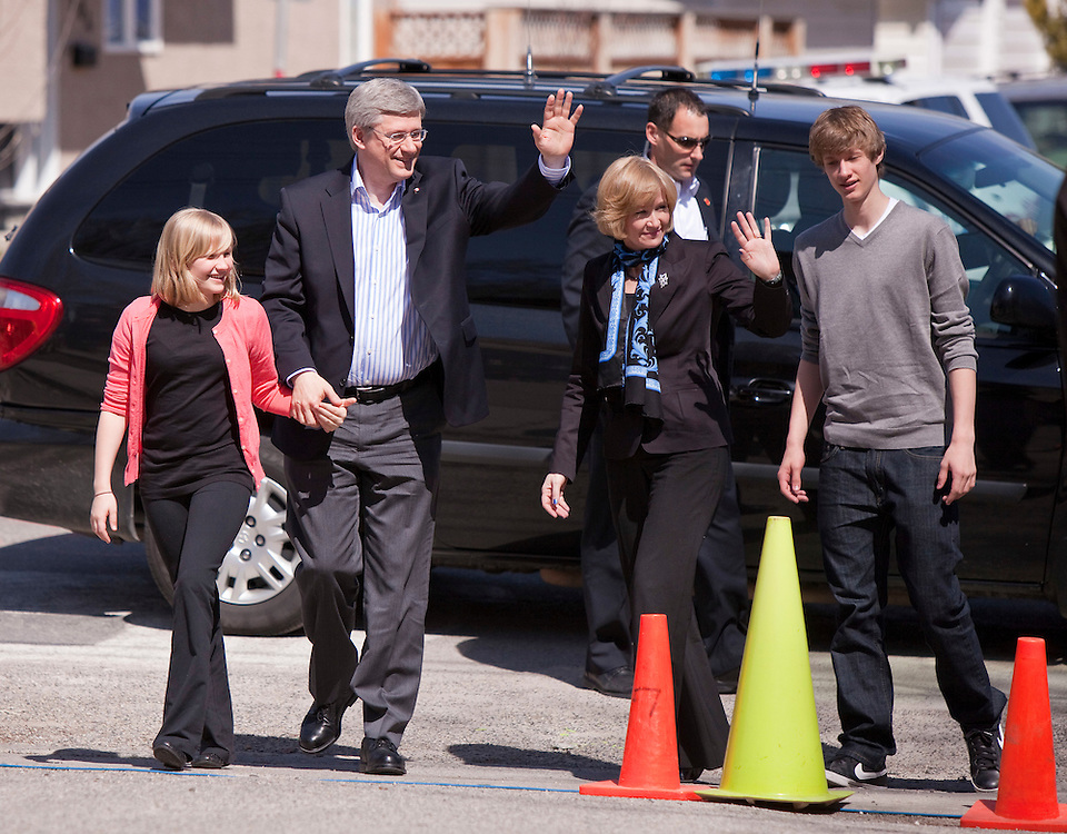 Conservative leader Prime Minister Stephen Harper arrives with his children Ben and Rachel and his wife Laureen to vote at St. Augustine Catholic school in Calgary, Alberta.<br /> AFP/GEOFF ROBINS/STR