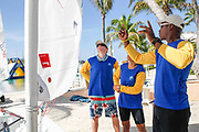 World Sailing Emerging Nations Program - Boca Chica Sailing Club, Santo Domingo 08/19/2017 - DAY 2 - Kwane Hinds, coach for Barbados explains a sail setting to his sailors Delith Morris and Kyle Spenard