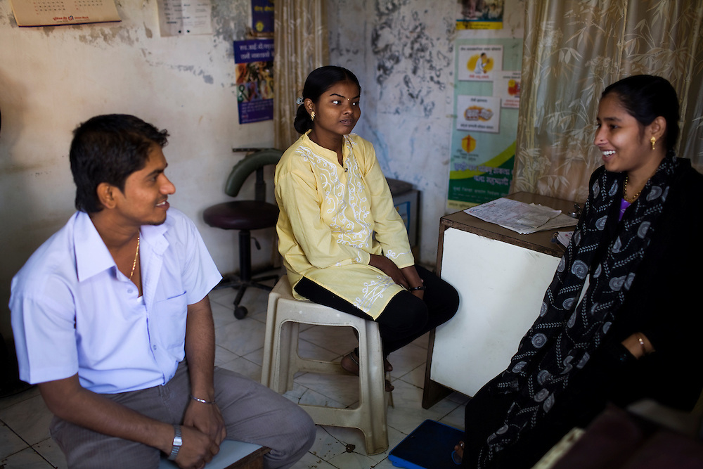 Neelam Khutekar(in yellow) is training to be a DOTS provider with Lok Seva Sangam, a local NGO that works in the slums of Mumbai.  Yasmeen Shaikh(in black) currently works for the NGO and is doing the training......