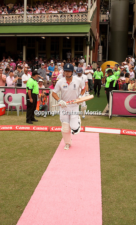 Alastair Cook is given the pink carpet treatment as he walks out to bat during the fifth and final Ashes test match between Australia and England at the SCG in Sydney, Australia. Photo: Graham Morris (Tel: +44(0)20 8969 4192 Email: sales@cricketpix.com) 05/01/11