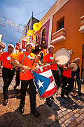 A band parades during the Festival of San Sebastian in San Juan, Puerto Rico.