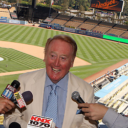 Hall of Fame broadcaster Vin Scully announced that he will return for a 62nd season with the Los Angeles Dodgers to broadcast both home and western division games before a Major League baseball game between the Cincinnati Reds and the Los Angeles Dodgers at Dodger Stadium on Sunday, August 22, 2010, in Los Angeles. (SGVN/Staff Photo by Keith Birmingham/SPORTS)