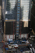 One World Trade Centre 104 story building at the site of the former world Trade Cemntre Twin towers in New York City. Image shows construction of final stages in 2011. The building began in 2006