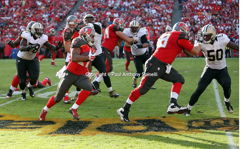 Tampa Bay Buccaneers running back Doug Martin (22) funs for a gain of 24 yards and a first down in the fourth quarter  during the 2015 week 14 regular season NFL football game against the New Orleans Saints on Sunday, Dec. 13, 2015 in Tampa, Fla. The Saints won the game 24-17. (©Paul Anthony Spinelli)