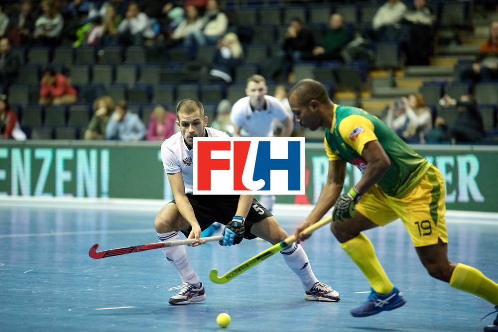 BERLIN - Indoor Hockey World Cup<br /> Men: Russia - South Africa<br /> foto: PROSKURIAKOV Mikhail duel with JONES Robin.<br /> COPYRIGHT WILLEM VERNES