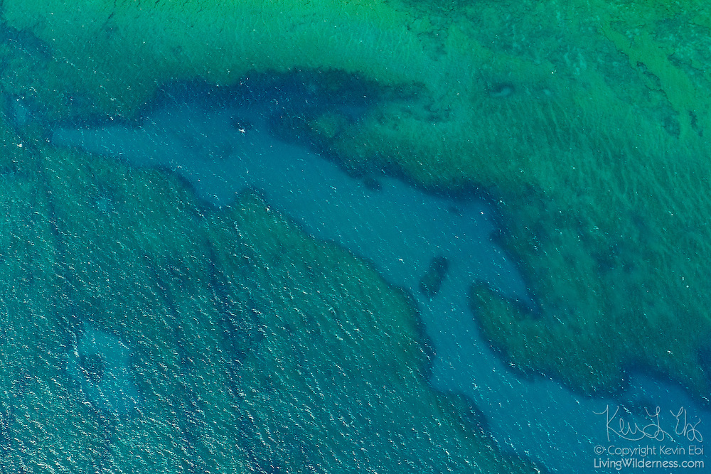 The outline a reef in shallow water is visible in this aerial view from the north coast of Kaua`i, Hawai`i.