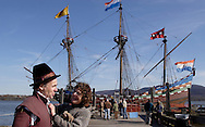 Newburgh, NY - A woman adjusts the collar of a reenactor dressed as Henry Hudson in front of the Half Moon, a full-scale, operating replica of the Dutch ship of exploration that Henry Hudson sailed in 1609, docked on the Hudson River during the finale of the Newburgh Beacon Bay Quadricentennial celebration on Nov. 7, 2009.