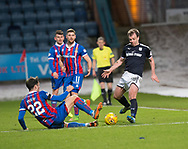 20th January 2018, Dens Park, Dundee, Scotland; Scottish Cup fourth round, Dundee versus Inverness Caledonian Thistle; Inverness Caledonian Thistle's Brad McKay tackles Dundee's Paul McGowan
