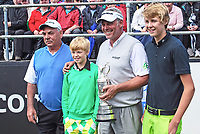 Darren Clarke, with his sons, Tyrone, green jersey, and Conor, navy jersey, and his father, Godrey Clarke, at the Pro-Am, Irish Open, Royal Portrush Golf Club, N Ireland. 201206275945<br />
