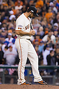 San Francisco Giants starting pitcher Madison Bumgarner (40) reacts to a 3-run home run hit by Chicago Cubs starting pitcher Jake Arrieta (49) during Game 3 of the NLDS at AT&T Park in San Francisco, Calif., on October 10, 2016. (Stan Olszewski/Special to S.F. Examiner)