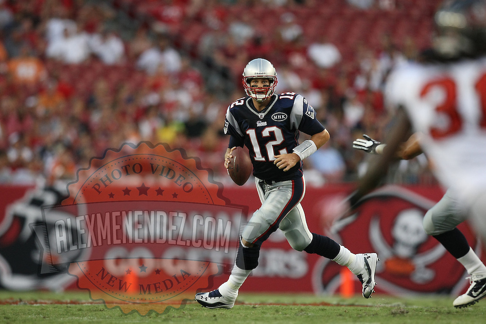 New England quarterback Tom Brady (12) scrambles with the football during an NFL football game between the New England Patriots and the Tampa Bay Buccaneers at Raymond James Stadium on Thursday, August 18, 2011 in Tampa, Florida.   (Photo/Alex Menendez)