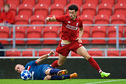 ST HELENS, ENGLAND - Wednesday, October 24, 2018: Liverpool's Curtis Jones has his shorts pulled down by FK Crvena zvezda's Luka Velikić during the UEFA Youth League Group C match between Liverpool FC and FK Crvena zvezda at Langtree Park. (Pic by David Rawcliffe/Propaganda)