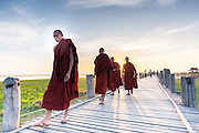 Buddhist monks strolling on U Bein bridge
