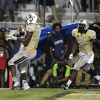 ORLANDO, FL - OCTOBER 09: William Stanback #28 of the UCF Knights scores the game winning touchdown in overtime at Bright House Networks Stadium on October 9, 2014 in Orlando, Florida. The Knights won the game 31-24. (Photo by Alex Menendez/Getty Images) *** Local Caption *** William Stanback