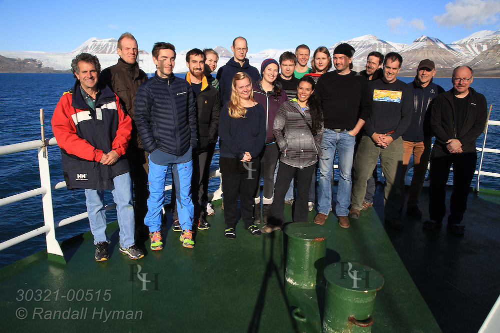Team of scientists pose for photo on bow of R/V Helmer Hanssen at end of CAGE research cruise; Svalbard, Norway.