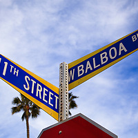 Photo of Balboa Boulevard and 11th Street sign on Balboa Peninsula in Newport Beach California. Newport Beach is a beach community along the Pacific Ocean in Orange County California.