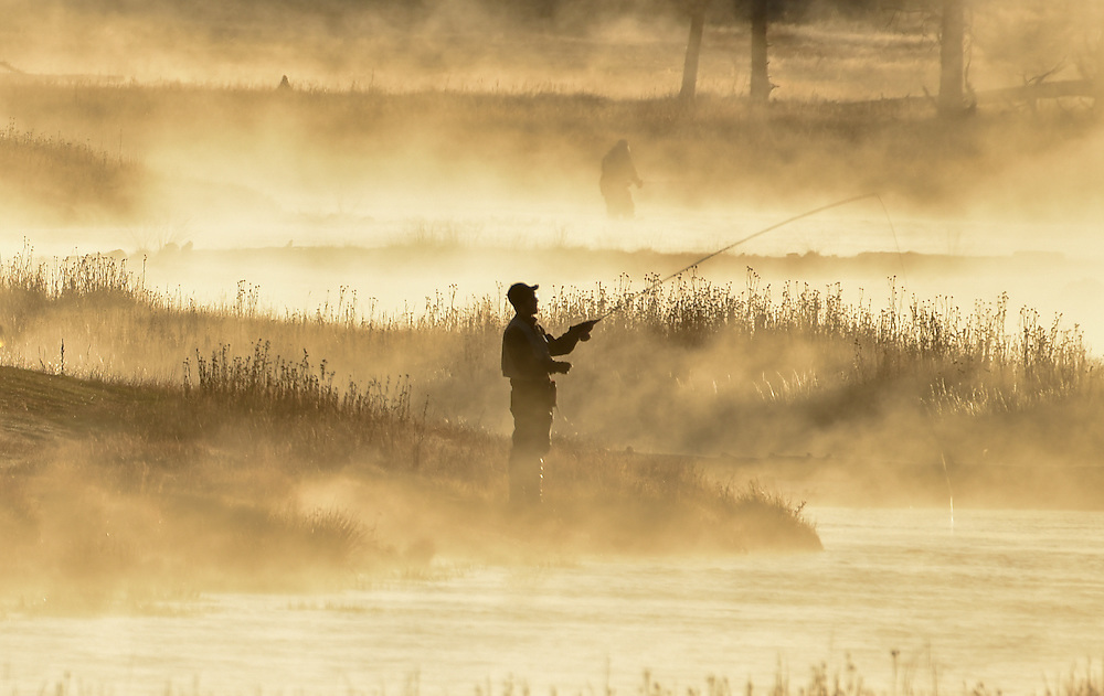 Fisherman in morning mist, Yellowstone National Park