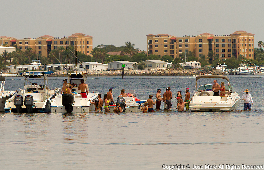 Boaters enjoy the warm waters on a sand bank. Photography by Jose More