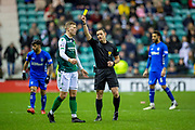 Referee Steven McLean shows a yellow card to Florian Kamberi (#22) of Hibernian FC during the Ladbrokes Scottish Premiership match between Hibernian and Rangers at Easter Road, Edinburgh, Scotland on 8 March 2019.