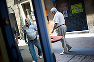 Local men walk from one bar to another in a street of the Northern Spanish Basque city of Bilbao, on August 25, 2011. Photo Rafa Rivas