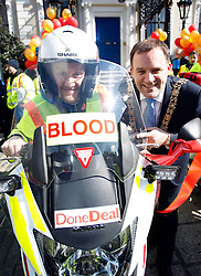 No fee for Repro: 02/01/2013 .Pictured at the launch of Blood Bike East is comedian and motorcycle enthusiast, PJ Gallagher and Lord Mayor of Dublin, Naoise Ó Muirí. Blood Bike East is a charitable organisation that delivers blood & medical products by motorbike between hospitals in Leinster free of charge. It is an entirely volunteer run organisation and Blood Bike East riders are highly trained and can safely negotiate traffic where large vehicles would be unable to do so, unless an emergency blue light vehicle is taken off an already overstretched service. DoneDeal's recent donation of ?32,309 facilitated the purchase of additional motorcycles and their maintenance which was key to today's launch that sees the service roll out across all of Leinster. Pic Andres Poveda